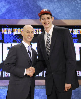 NBA DRAFT: NBA deputy commissioner Adam Silver, left, poses with Tibor Pleiss, of Germany, who was selected by the New Jersey Nets in the second round of the NBA basketball draft, Thursday, June 24, 2010 in New York. (AP Photo/Bill Kostroun) ORG XMIT: NYJD136