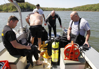 OHP troopers prepare their dive equipment as the Oklahoma Highway Patrol Dive Team spends the day floating a submerged boat and car from the bottom of Lake Tenkiller near Gore, OK, as part of ongoing training exercises, Tuesday, May 6, 2014, Photo by Paul Hellstern, The Oklahoman