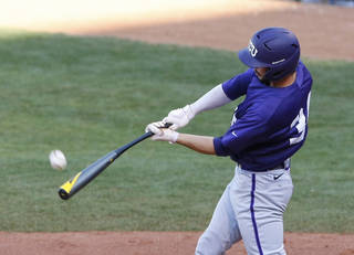 TCU's Garrett Crain gets a hit in the eighth inning of a second-round game against TCU in the Big 12 conference NCAA college baseball tournament in Oklahoma City, Thursday, May 22, 2014. (AP Photo/Alonzo Adams)