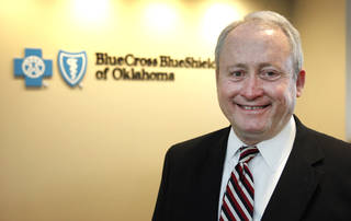 Ted Haynes, chief executive of BlueCross and BlueShield of Oklahoma, visits the company's Oklahoma City offices on the third floor of the IBC Bank building on Northwest Expressway. Photo by David McDaniel, The Oklahoman David McDaniel