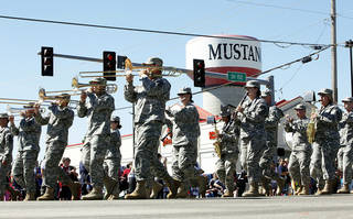 The 395th Army Band marches in the Mustang Western Days parade in 2012. Photo By Paul Hellstern, The Oklahoman Archives PAUL HELLSTERN -