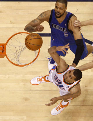 Oklahoma City's Thabo Sefolosha (2) shoots the ball beside Tyson Chandler (6) of Dallas during game 4 of the Western Conference Finals in the NBA basketball playoffs between the Dallas Mavericks and the Oklahoma City Thunder at the Oklahoma City Arena in downtown Oklahoma City, Monday, May 23, 2011. Dallas won in overtime, 112-105. Photo by Bryan Terry, The Oklahoman