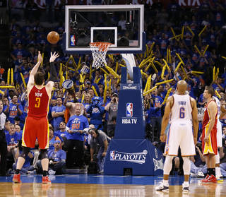 Houston's Omer Asik (3) takes a foul shot with 5:33 left in the fourth quarter after being intentionally fouled during Game 5 in the first round of the NBA playoffs between the Oklahoma City Thunder and the Houston Rockets at Chesapeake Energy Arena in Oklahoma City, Wednesday, May 1, 2013. Houston won, 107-100. Photo by Nate Billings, The Oklahoman