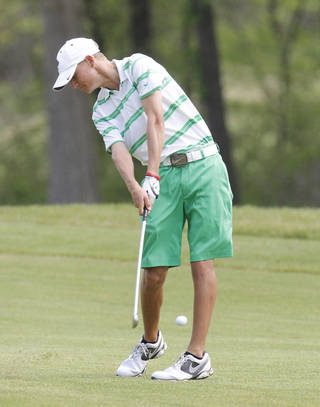 Edmond Santa Fe's Max McGreevy hits a shot from the fairway during Boy's 6A golf championships at the Karsten Creek Golf Course in Stillwater, OK, Tuesday, May 7, 2013, By Paul Hellstern, The Oklahoman