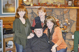Reba McEntire, Alice Foran and Susie McEntire Eaton, from left, are with their father, Clark McEntire, on Thanksgiving Day 2011. Photo Provided