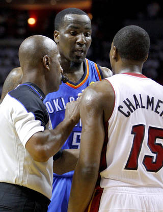 Oklahoma City's Kendrick Perkins (5) argues with Miami's Mario Chalmers (15) during Game 5 of the NBA Finals between the Oklahoma City Thunder and the Miami Heat at American Airlines Arena, Thursday, June 21, 2012. Photo by Bryan Terry, The Oklahoman