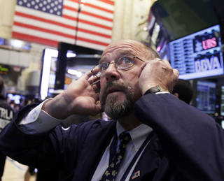 Trader Frederick Reimer works Sept. 20 on the floor of the New York Stock Exchange. AP Photo