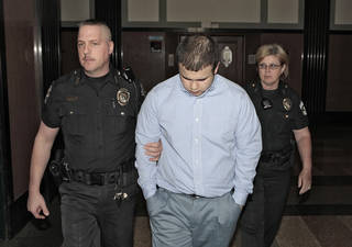 Tristan Owen is escorted from a courtroom Monday in Oklahoma City. Photo By David McDaniel, The Oklahoman