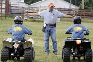 Instructor Mike Klumpp gives hand signals during a children's ATV safety course at the Logan County Fairgounds in Guthrie, OK, Friday, May 25, 2012, By Paul Hellstern, The Oklahoman