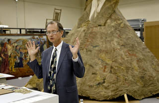 """Bob Blackburn, executive director of the Oklahoma History Center, speaks Monday about a bison-hide Kiowa war tepee in the storage facility at the Oklahoma History Museum. The tepee sat for more than 80 years in storage before a curator stumbled across the artifact recently and realized its significance. The tepee — now fully erected in the basement of the History Center — was a key prop in the 1920 silent film """"Daughter of Dawn"""" filmed in the Wichita Mountains near Lawton. Photo by CHRIS LANDSBERGER, the Oklahoman"""