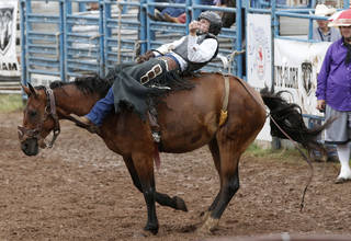 Taylor Howell, of Warner, competes in the bareback bronc event in July 10's action at the International Finals Youth Rodeo at the Heart of Exposition Center in Shawnee. Howell has been completely blind since age 2 because of a rare form of cancer known as retinoblastoma. Photos by Paul Hellstern, The Oklahoman PAUL HELLSTERN -