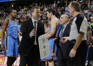 Oklahoma City Thunder head coach Scott Brooks, center left, argues call against his team with official Zach Zarba in overtime of an NBA basketball game against the Denver Nuggests in Denver on Sunday, Jan. 20, 2013. The Nuggets won 121-118 in overtime. (AP Photo/David Zalubowski) ORG XMIT: CODZ108