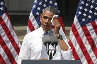 President Barack Obama wipes perspiration from his face as he speaks about climate change June 25 at Georgetown University in Washington. AP File Photo Charles Dharapak - AP