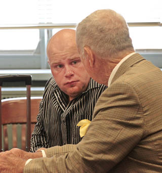 Justin Adams, man once charged with pregnant wife's death, now facing manslaughter charges talks with his attorney Irving Box in Judge D. Fred Doak's courtroom at the County Courthouse. David McDaniel - The Oklahoman