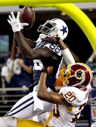 Washington Redskins defensive back Cedric Griffin (20) breaks up a pass in the end zone intended for Dallas Cowboys' Dez Bryant (88) late in the second half of an NFL football game, Thursday, Nov. 22, 2012, in Arlington, Texas. The Redskins won 38-31. (AP Photo/Tim Sharp) ORG XMIT: CBS152