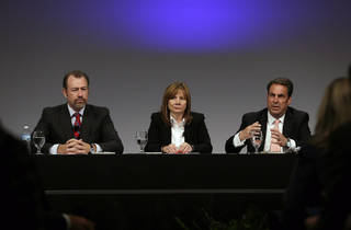 General Motors President Dan Ammann, left, CEO Mary Barra, and Executive Vice President Mark Reuss, hold a news conference Thursday at the General Motors Technical Center in Warren, Mich. AP Photo Carlos Osorio - AP