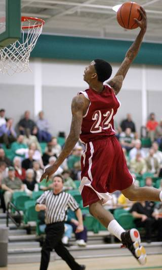 Ardmore's Nino Jackson dunks the ball against Bishop McGuinness during a high school basketball game at Bishop McGuinness in Oklahoma City, Tuesday, Feb. 15, 2011. Photo by Bryan Terry, The Oklahoman ORG XMIT: KOD