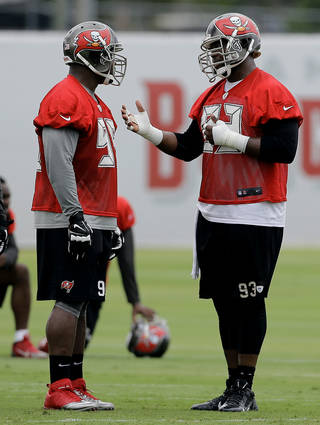 Tampa Bay Buccaneers defensive tackle Gerald McCoy (93) talks to Clinton McDonald (98) during an NFL football minicamp Wednesday, June 11, 2014, in Tampa, Fla. (AP Photo/Chris O'Meara) Chris O'Meara