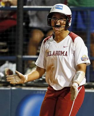 OU's Lauren Chamberlain (44) reacts after scoring in the third inning during an NCAA softball game in the Women's College World Series between Oklahoma and Michigan at ASA Hall of Fame Stadium, Thursday, May 30, 2013. Photo by Nate Billings, The Oklahoman