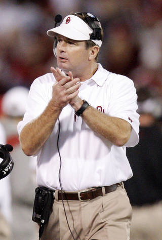 OU head coach Bob Stoops claps on the sideline during the college football game between the University of Oklahoma (OU) Sooners and the University of Colorado Buffaloes at Gaylord Family-Oklahoma Memorial Stadium in Norman, Okla., Saturday, October 30, 2010. Photo by Nate Billings, The Oklahoman