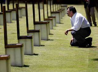 Lt. Gov. Matt Michels, of South Dakota, looks at the chairs July 18 during at tour of the Oklahoma City National Memorial & Museum. SARAH PHIPPS