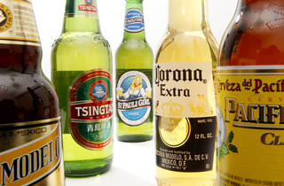 """FILE - In this Oct. 5, 2010 photo shows bottles of Constellation Brands, Inc., beer products, including, from left, Negra Modelo, Tsingtao, St. Pauli Girl, Corona Extra and Pacifico in Philadelphia. Constellation Brands, maker of Svedka vodka and Black Velvet whiskey, gave its CEO a $10,000 """"product allowance,"""" so he could enhance his """"knowledge and appreciation of our products."""" CEO Robert Sands, who made $7.7 million in fiscal 2012, used up $5,532 last year. (AP Photo/Matt Rourke) ORG XMIT: NYBZ201"""