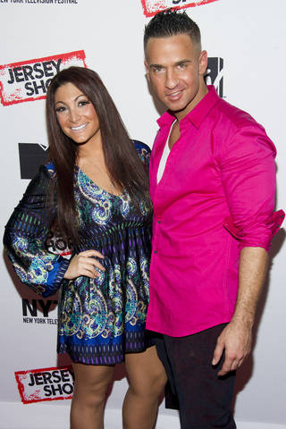 "Jersey Shore cast members Deena Cortese and Mike ""The Situation"" Sorrentino attend a panel entitled ""Love, Loss, (Gym, Tan) and Laundry: A Farewell to the Jersey Shore"" on Wednesday, Oct. 24, 2012 in New York. (Photo by Charles Sykes/Invision/AP) ORG XMIT: CAENT461"