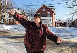 "Victoria DeLong of Rutland, Vt., pointing out a house where drug dealing occurs. ""We know what they're doing in there,"" she said. Cheryl Senter for The New York Times"
