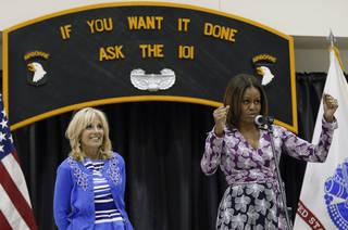 First lady Michelle Obama, accompanied by Jill Biden, wife of Vice President Joe Biden, speaks to military families Wednesday at Fort Campbell, Ky. AP Photo Mark Humphrey - AP