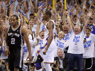 The crowd reacts after Oklahoma City's Kevin Durant (35) made a basket as San Antonio's Kawhi Leonard (2) watches during Game 4 of the Western Conference Finals between the Oklahoma City Thunder and the San Antonio Spurs in the NBA playoffs at the Chesapeake Energy Arena in Oklahoma City, Saturday, June 2, 2012. Oklahoma CIty won 109-103. Photo by Bryan Terry, The Oklahoman
