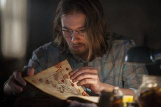 """Lou Taylor Pucci in TriStar Pictures' horror film """"Evil Dead."""" Five friends discover the Book of the Dead in this remake of Sam Raimi's 1981 film. Sony Pictures photo"""