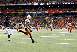 Oklahoma State's Justin Blackmon (81) tip-toes the goal line before scoring a touchdown in front of Arizona's Adam Hall (12) during the Valero Alamo Bowl college football game between the Oklahoma State University Cowboys (OSU) and the University of Arizona Wildcats at the Alamodome in San Antonio, Texas, Wednesday, December 29, 2010. Photo by Sarah Phipps, The Oklahoman ORG XMIT: KOD