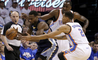 Oklahoma City's Kendrick Perkins (5) and Thabo Sefolosha (2) defend Memphis' Tony Allen (9) during Game 2 in the second round of the NBA playoffs between the Oklahoma City Thunder and the Memphis Grizzlies at Chesapeake Energy Arena in Oklahoma City, Tuesday, May 7, 2013. Photo by Bryan Terry, The Oklahoman