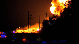 In this image from video, a fire burns at Danlin Industries late Wednesday, Sept 18, 2013 near Thomas, Okla. The plant produces chemicals for the oil and gas industry. No injuries were reported. (AP Photo/KWTV News 9)