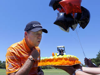 Scott Verplank blows out the candles on his 50th birthday cake presented to him by the USGA during practice rounds for the U.S. Senior Open golf tournament at Oak Tree National in Edmond, Okla. on Wednesday, July 9, 2014. Photo by Chris Landsberger, The Oklahoman