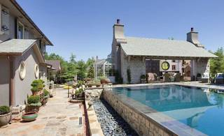 Terry and Anders Carlson's backyard and outdoor spaces, 6634 Avondale Drive, are among the stops on the Nichols Hills Garden Tour June 1. - PROVIDED