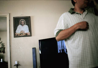 Gabriel, an undocumented worker planning to voluntarily move back to Mexico, is shown in the living room of the house he bought in Oklahoma City. PHOTO BY JOHN CLANTON, THE OKLAHOMAN