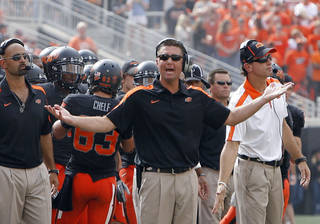 Oklahoma State head coach argues a call during the first half of the college football game between the Oklahoma State University Cowboys (OSU) and the University of Kansas Jayhawks (KU) at Boone Pickens Stadium in Stillwater, Okla., Saturday, Oct. 8, 2011. Photo by Sarah Phipps, The Oklahoman