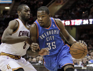 Oklahoma City Thunder's Kevin Durant (35) drives past Cleveland Cavaliers' Christian Eyenga (8), from the Republic of the Congo, in the first quarter of an NBA basketball game on Sunday, March 13, 2011, in Cleveland. (AP Photo/Mark Duncan)
