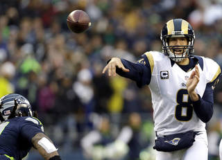 St. Louis Rams quarterback Sam Bradford passes against the Seattle Seahawks in the second half of an NFL football game, Sunday, Dec. 30, 2012, in Seattle. (AP Photo/Elaine Thompson) ORG XMIT: SEA120