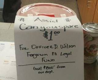 This bucket requesting donations for Ferguson, Mo., Police Officer Darren Wilson's legal fund was at the Tulsa Police Department's Gilcrease Division on Saturday. Tulsa Police Chief Chuck Jordan said he ordered it removed. Photo via Tulsa World.