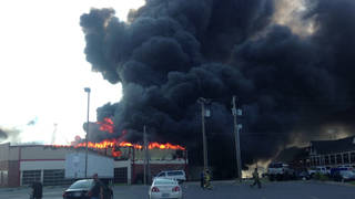 The Hibdon Tire Plus near Interstate 35 and Main Street in Norman caught fire Sunday evening. PROVIDED - PROVIDED