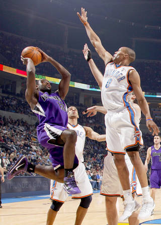 OKC's Russell Westbrook, right, and Thabo Sefolosha defend Sacramento's Tyreke Evans, left, during action on Tuesday. Photo by Bryan Terry, The Oklahoman