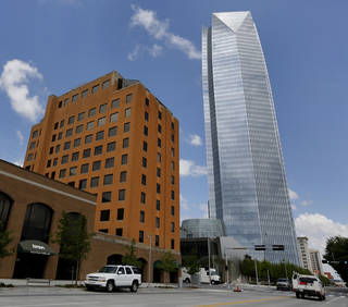 "The Greater Oklahoma City Chamber on Tuesday reported that Class A office space downtown is virtually non-existant despite the opening last year of the 50-story Devon Energy Center, shown to the right. Nicholas Preftakes, owner of the One North Hudson Building, left, is emptying the building for future ""redevelopment."" Steve Gooch"