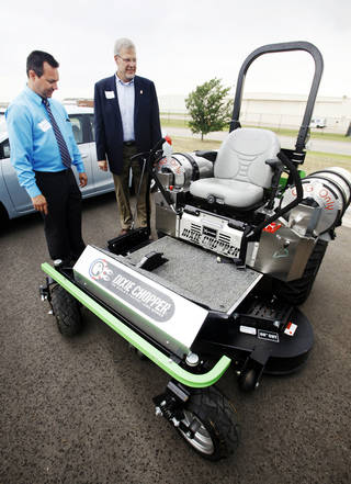 Norman Fleet Superintendent Mike White, left, and City Manager Steve Lewis examine the city's latest compressed natural gas acquisition, a cng-powered industrial lawn mower. PHOTO BY PAUL B. Southerland, THE OKLAHOMAN PAUL B. SOUTHERLAND