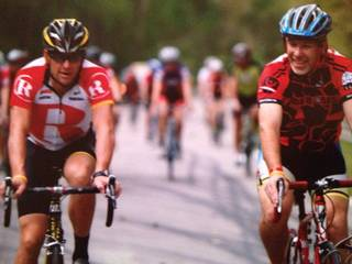 Lance Armstrong and Jerry Burnstein riding together in a Livestrong event. PHOTO PROVIDED