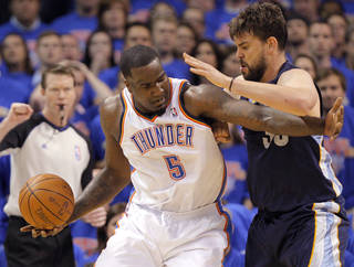 OKLAHOMA CITY ARENA / PLAYOFFS: Oklahoma City's Kendrick Perkins (5) tries to get by Marc Gasol (33) of Memphis during game 7 of the NBA basketball Western Conference semifinals between the Memphis Grizzlies and the Oklahoma City Thunder at the OKC Arena in Oklahoma City, Sunday, May 15, 2011. Photo by Sarah Phipps, The Oklahoman ORG XMIT: KOD