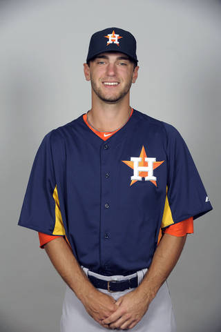 MAJOR LEAGUE BASEBALL: KISSIMMEE, FL - FEBRUARY 21: Jarred Cosart #48 of the Houston Astros poses during Photo Day on Thursday, February 21, 2012 at Osceola County Stadium at Osceola Heritage Park in Kissimmee, Florida. (Photo by Tony Firriolo/MLB Photos via Getty Images) *** Local Caption *** Jarred Cosart ORG XMIT: 159448084