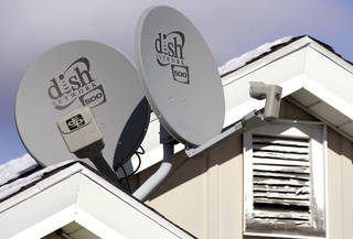 Dish Network Corp. satellite dishes are attached to a home in Buffalo, N.Y. AP File Photo David Duprey - AP
