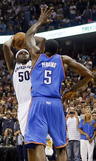 Oklahoma City's Kendrick Perkins (5) goes up to block the final shot in regulation by Memphis' Zach Randolph (50) during Game 4 of the second-round NBA basketball playoff series between the Oklahoma City Thunder and the Memphis Grizzlies at FedExForum in Memphis, Tenn., Monday, May 13, 2013. Memphis won 103-97 in overtime. Photo by Nate Billings, The Oklahoman
